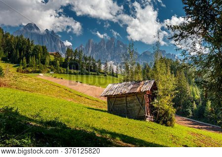 Awesome Sunny Landscape. Dolomite Alps. Napure Background. Santa Maddalena Village In Front Of The G