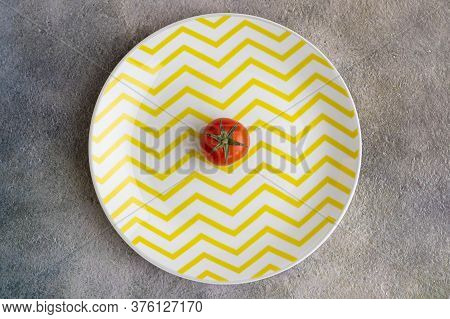 Cherry Tomatoes On Yellow Plate And Brushstroke Background