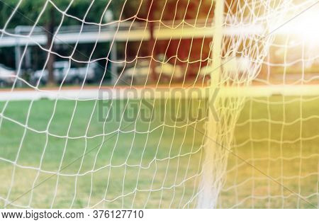 Soft Focus Sun Flare Through Football Net. Close Up On White Football Net.