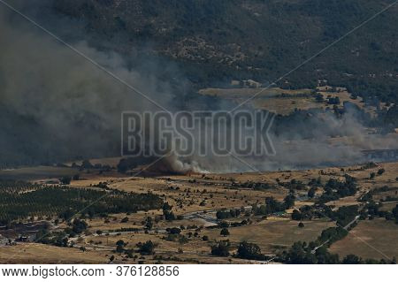 View From The Glozhene Monastery To A Fire In The Mountain Valley Of The Central Balkans, Near The T