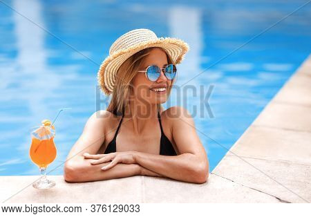 Happy Blonde Girl With Cocktail Drink Relaxing At Poolside, Copy Space
