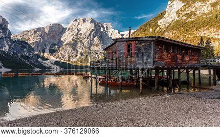 Sunny Morning At Famouse Mountain Lake In Dolomites Alps. Wonderful Braies Lake During Sunrise. Amaz
