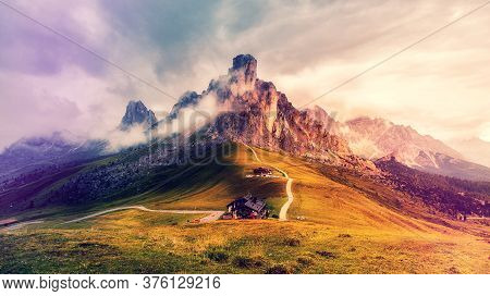 Awesome Nature Landscape. Fantastic View Of Famous Dolomites Mountain Peaks Glowing In Beautiful Gol