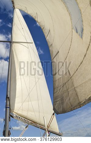 Mast With Sails Against The Blue Sky
