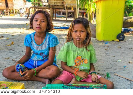 Surin Islands, Phang-nga, Thailand - January 3, 2016: Sea Gypsies Little Girls Selling Necklaces And