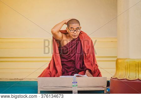 Pagan-myanmar, January 21, 2019 : Unidentified Monk Meditate And Pray With Buddhist Scriptures At Sh