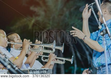 Kanchanaburi-thailand, April 12 : Unidentified Male Student With Friends Blow The Trumpet With The B