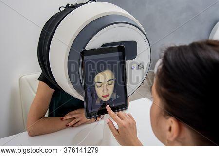 Face Skin Analyze System. Cosmetologist Analyzing Woman Face.