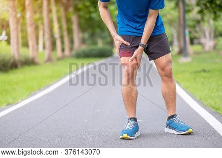 Young Adult Male With Muscle Pain During Running. Runner Have Leg Ache Due To Iliotibial Band Syndro