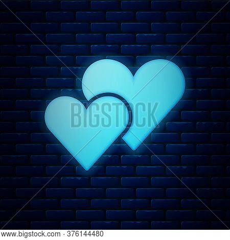 Glowing Neon Heart Icon Isolated On Brick Wall Background. Romantic Symbol Linked, Join, Passion And