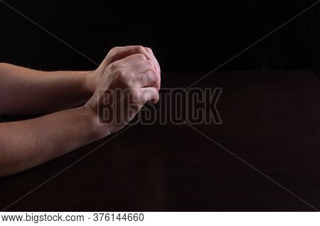 Womens Hands On The Table. Expression Of Confusion And Uncertainty. Low Key.
