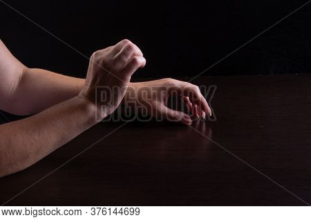 Womens Hands On The Table. Expression Of Vulnerability. Low Key