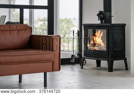Modern Interior House With Bright Living Room, Fire In New Fireplace, Comfortable Leather Couch On C