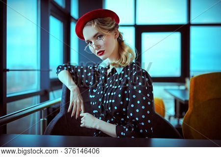 Portrait of an elegant young woman with make-up and clothes in pin-up style. Beauty, fashion. Optics and eyewear.