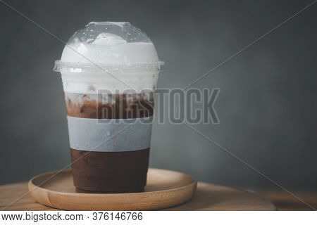 Iced Mocha Coffee With Milk Cream On Wood Table At Cafe