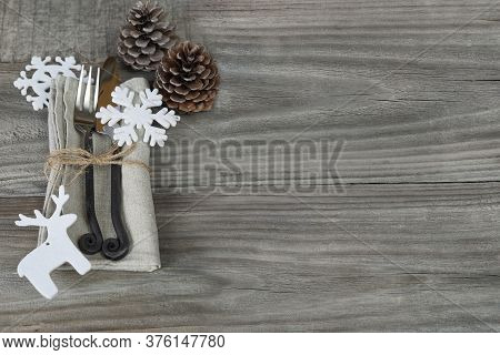 Steel Fork And Knife Handmade Lie On A Linen Napkin Tied With Rough Twine As Well As Two Pine Cones