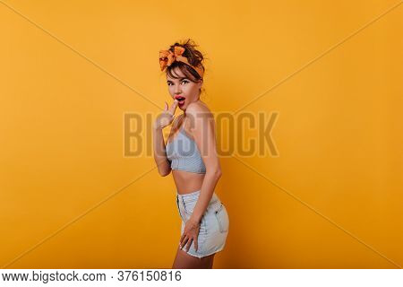 Attractive Graceful Girl With Elegant Retro Hairstyle Posing In Studio. Indoor Portrait Of Slim Fema