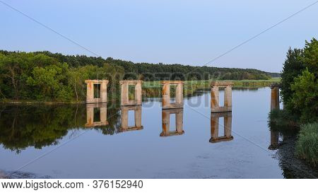 Old Bridge Support. The Pillar Of The Old Bridge, The Pillar Of The Destroyed Bridge, Stands In The