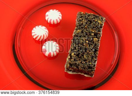 Peppermint Chocolate Nutrition Bar With Icing And Three Peppermint Hard Candies On Ted Plate
