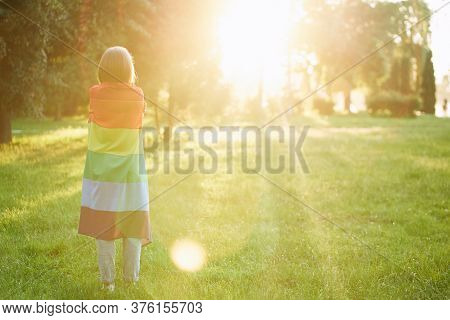 Back View Of Unrecognizable Tolerant Woman Posing In Park, Enjoying Summer Sunset. Incognito Girl Ho