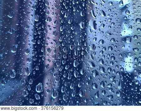 Raindrops On Glass On A Cloudy Day. Background Blank For The Designer