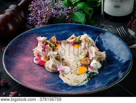 Ravioli Stuffed With Ricotta And Basil Garnish With Cream And Asparagus, Italian Dumplings With Sauc