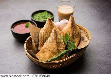 Samosa snack Is An Indian Deep Fried Pastry With A Spiced Filling Usually Made With Potatoes, Spices