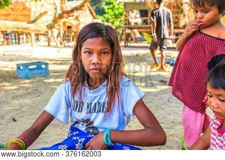 Surin Islands, Ko Phra Thong, Thailand - January 3, 2016: Portrait Of A Sea Gypsies Girl Vendor Of N