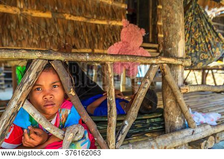 Surin Islands, Ko Phra Thong, Thailand - January 3, 2016: Little Sea Gypsy Moken Boy Resting In His