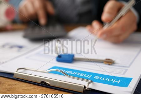 Man Considers On Calculator And Fills Out Document. Landlord Decides With Whom To Sign Lease. Tenant
