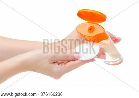 Hand Holding Bottle Micellar Water Tonic Beauty Product With Cotton Pad On White Background Isolatio