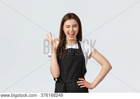 Grocery Store Employees, Small Business And Coffee Shops Concept. Cheerful Happy Smiling Barista Say