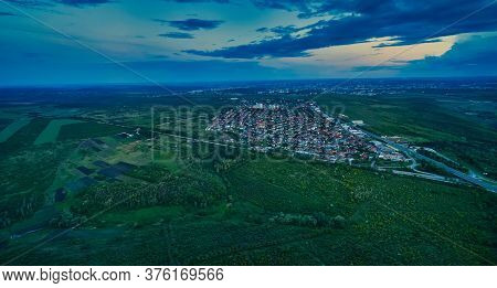 Aerial View From Drone. Aerial View Amazing Sunset Over Of The Suburbs With The City, Far Villages A