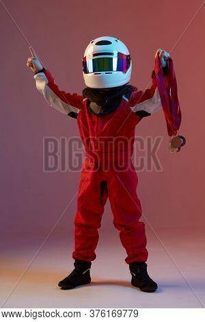 Cool Boy Child Racer In Helmet With Medals, Standing In Neon Light. Kart Racing School Poster. Compe