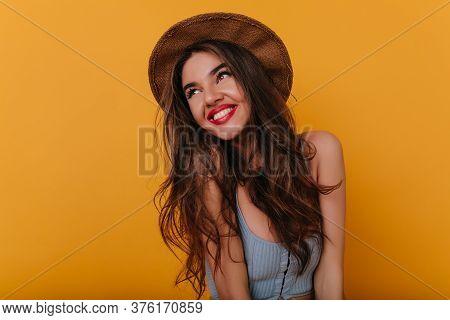 Easygoing Brunette Woman Dreamy Posing On Yellow Background. Studio Shot Of Romantic Caucasian Girl