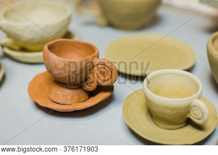 Unfinished Tea Cups On Shelf Of Pottery Workshop, Ceramic Studio - Close Up View. Crafting, Diy, Art