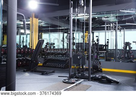 Empty Gym Interior Background With Fitness And Weight-lifting Machines And Equipment, Nobody