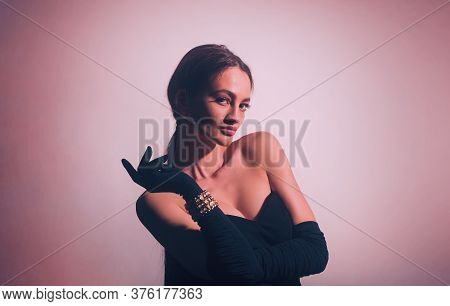 Sexy Brunette Woman In Black Dress And Gloves. Big Boobs.
