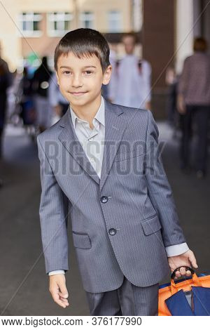 Back To School Portrait Of A Young Boy With A Backpack And A Business Suit