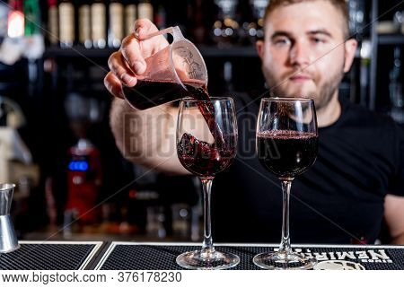 Bartender Pours Red Wine Into A Glass. Sommelier. Restaurant. Nightlife