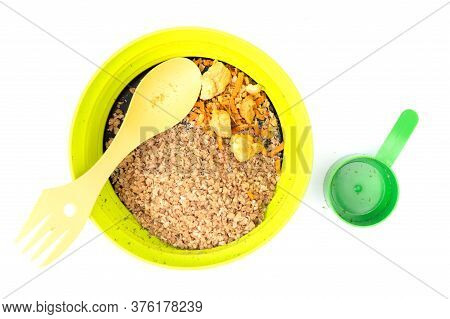 A Serving Of Buckwheat Porridge With Appliances. Plate Of Buckwheat Porridge.