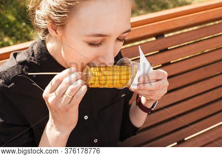 Girl Eating Corn On The Cob With Closed Eyes Closeup. Tasty Maize