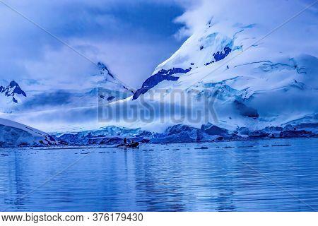 Rubbert Boat Tourists Blue Glacier Snow Mountains Paradise Bay Skintorp Cove Antarctica.