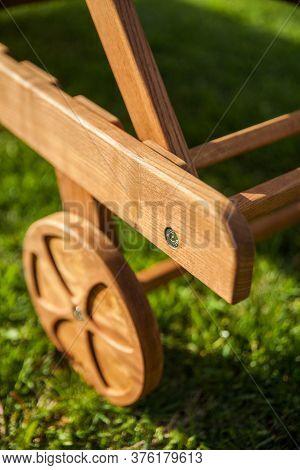 Deck Chair Wooden Wheel On Green Grass