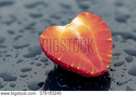 Daylight. Red Strawberries On A Blue Background. Drops Of Water Around The Berry