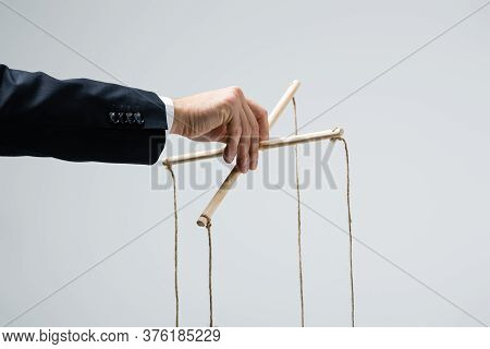 Cropped View Of Puppeteer In Suit Holding Marionette Isolated On Grey