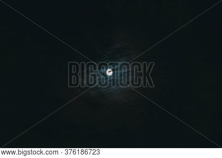 Mysterious Night Sky With Full Moon. Concept Of A Spooky Theme And Mystery. Dramatic Clouds In The M