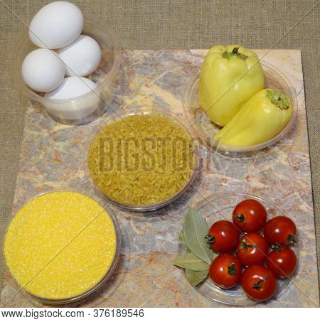 Ingredients For Instant Cooking Of Delicious Bulgur: Eggs, Bell Peppers, Cherry Tomatoes, Corn Grits