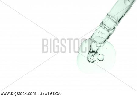 Cosmetic Pipette With Serum Smear Smudge Drop Swatch Of Collagen And Peptides Closeup Isolated On Wh