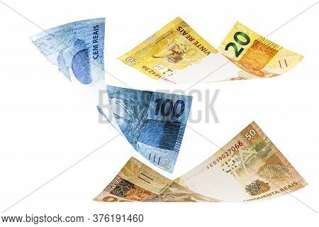 Twenty, Fifty And One Hundred Reais Bills Falling, Money From Brazil On Isolated White Background. M
